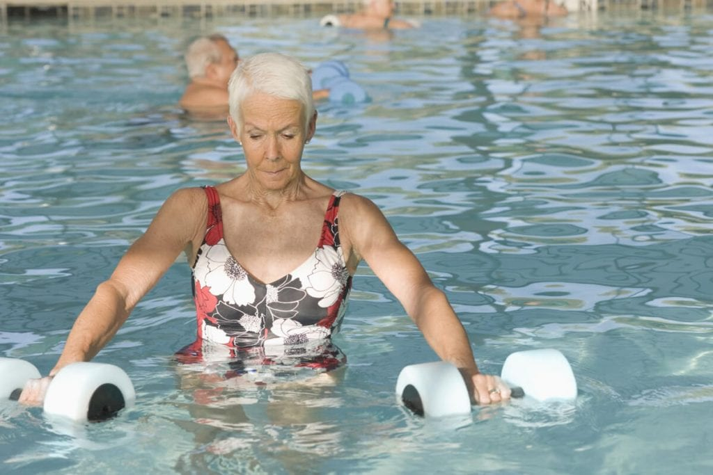 Woman has chronic diseases and performs Kaenz exercises.