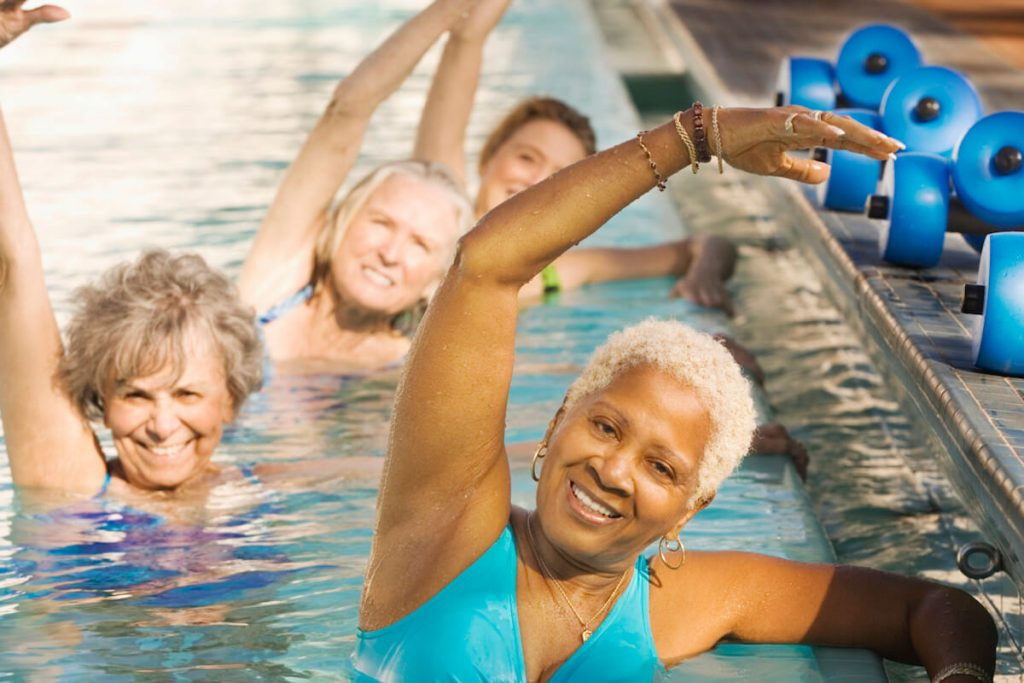 People with orthopedic surgery doing aquatic physical therapy in pool.