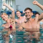 People doing exercises for hypertension in the pool.
