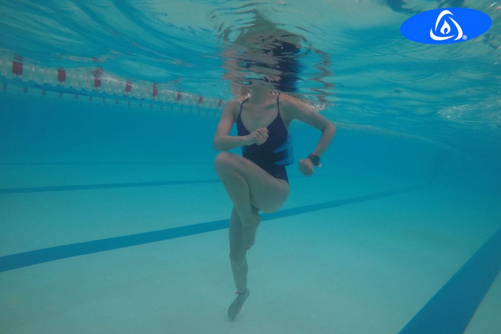 Woman doing Kaenz exercises in tempered pool.