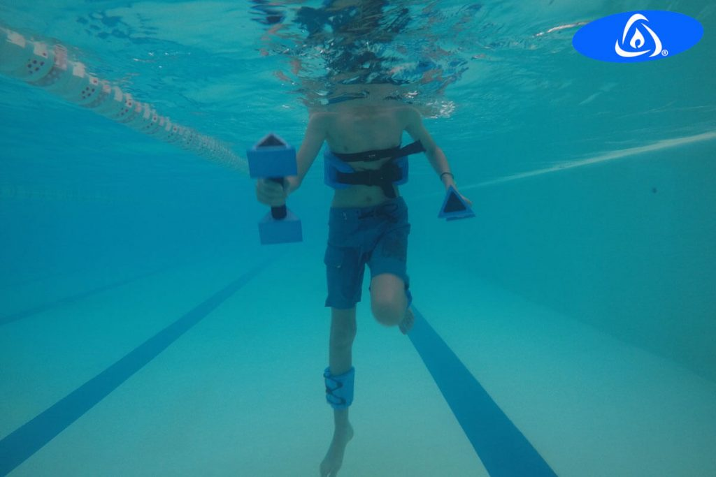 Man, with Parkinson's disease doing Kaenz aquatic exercises in tempered pool.