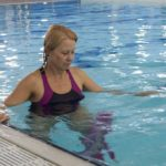 Woman knee osteoarthritis doing aquatic therapy and pool exercise.