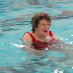 Woman with hip and knee arthroplasty doing aquatic exercise.